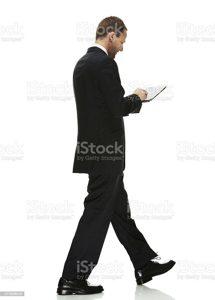 Mid adult businessman using digital tablet royalty-free stock photo
