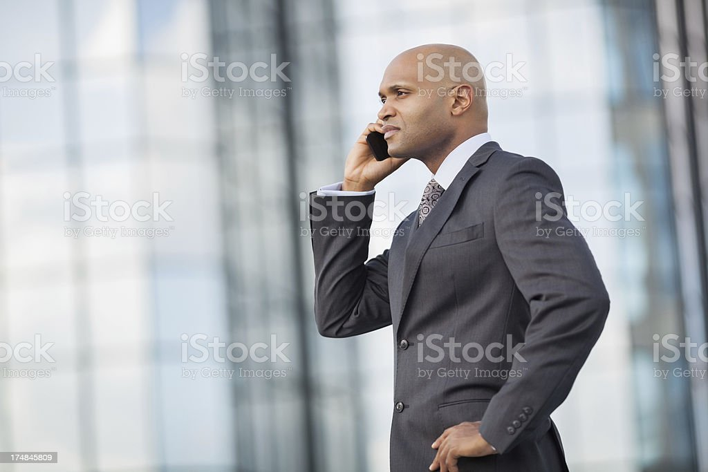 Mid Adult Businessman Using Mobile Phone royalty-free stock photo