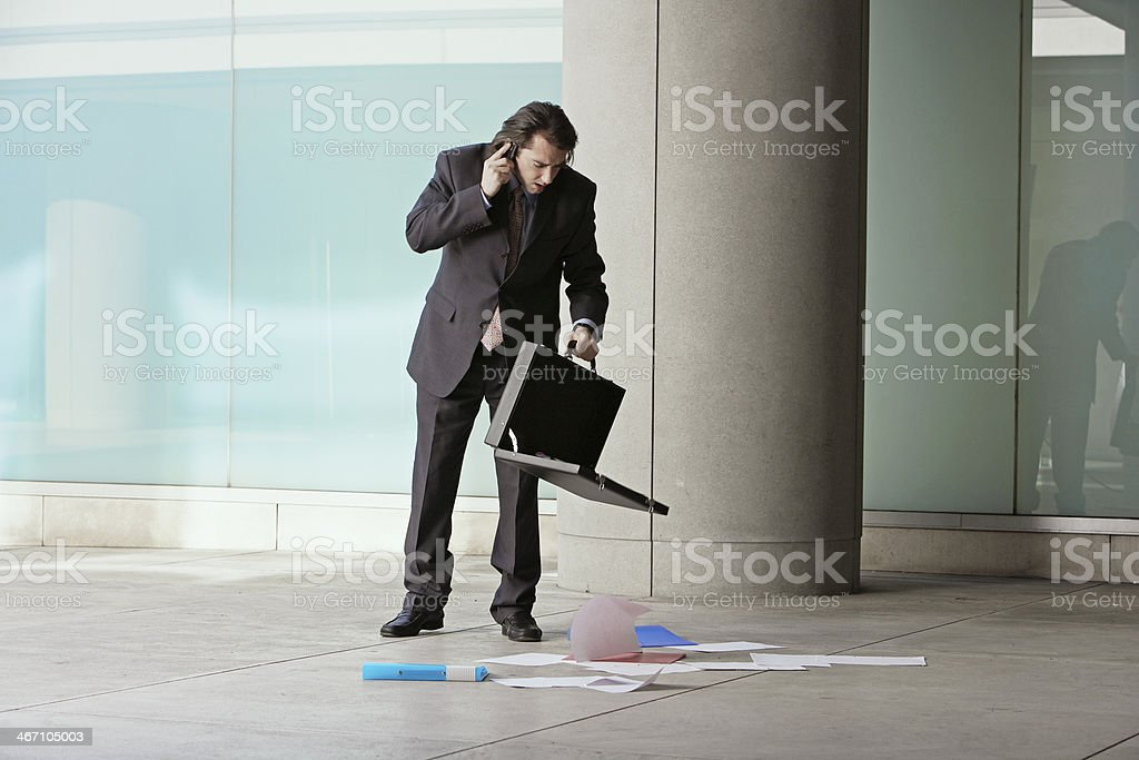 Mid Adult Businessman with Documents on Floor stock photo