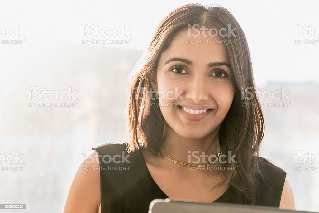 Mid adult businesswoman smiling towards the camera stock photo