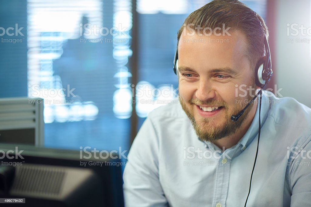 mid adult call centre call handler stock photo