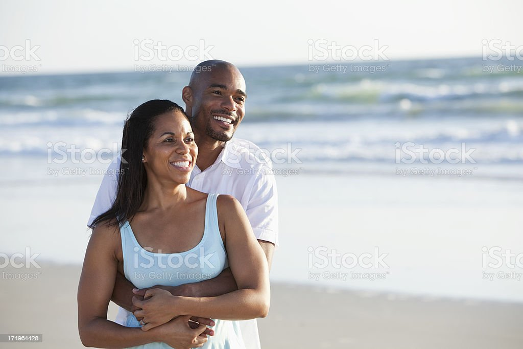 Mid adult couple at the beach stock photo