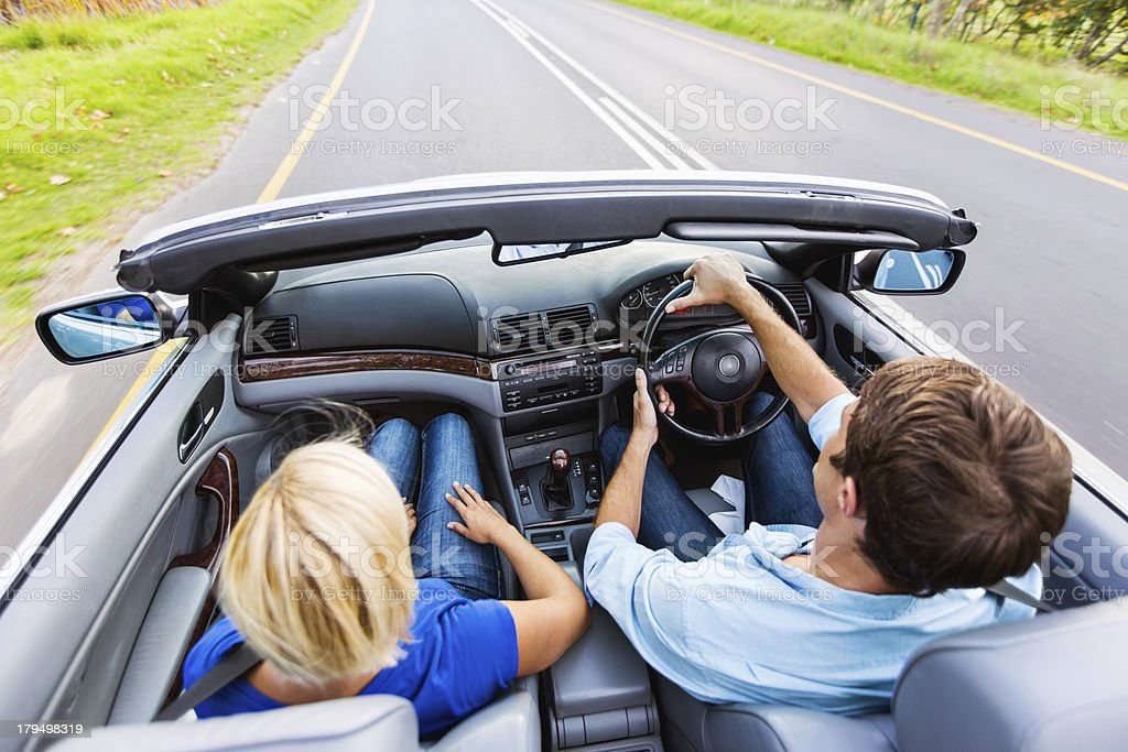 Mid Adult Couple In Convertible Car During Road Trip royalty-free stock photo