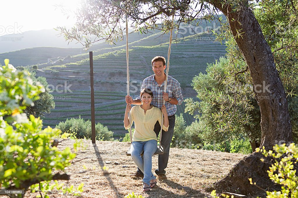 Mid adult couple on a swing royalty-free stock photo