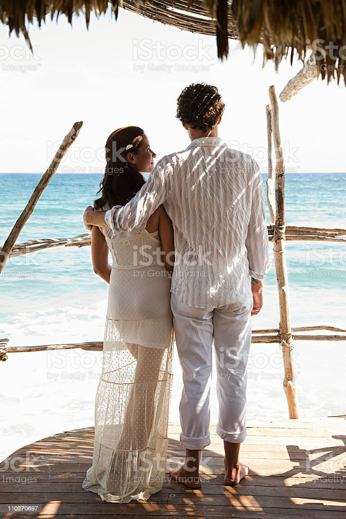 Mid adult couple on vacation in beach hut stock photo