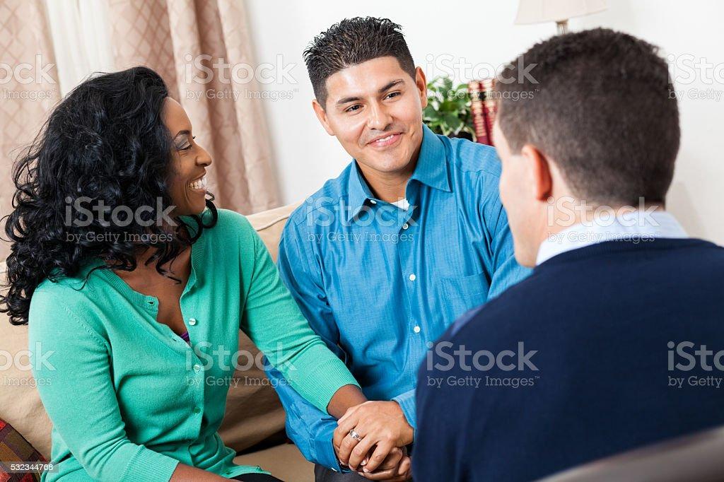 Mid adult couple talk with financial advisor stock photo