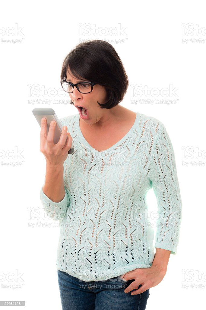 Mid adult female yelling at phone stock photo