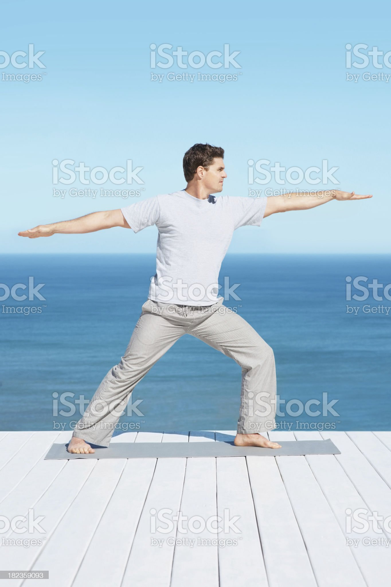 Mid adult fit man practicing yoga royalty-free stock photo