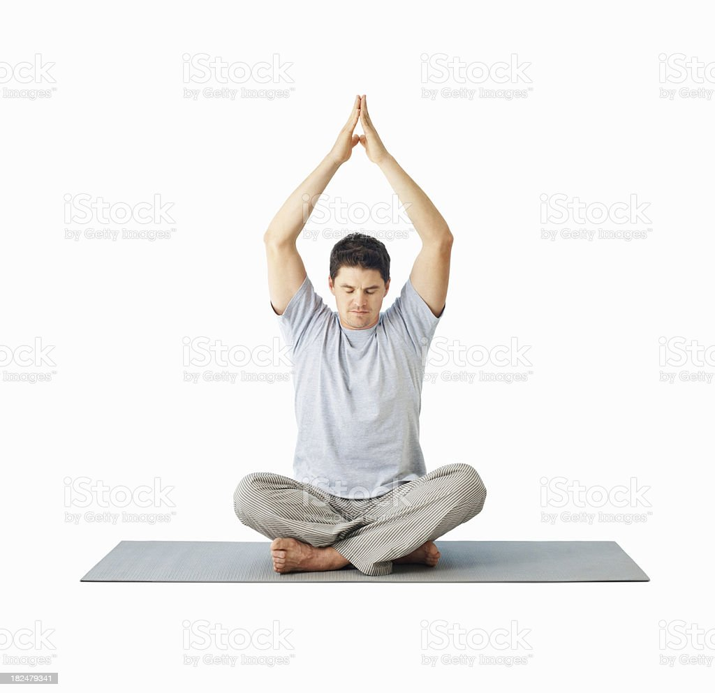 Mid adult guy practicing yoga over white royalty-free stock photo