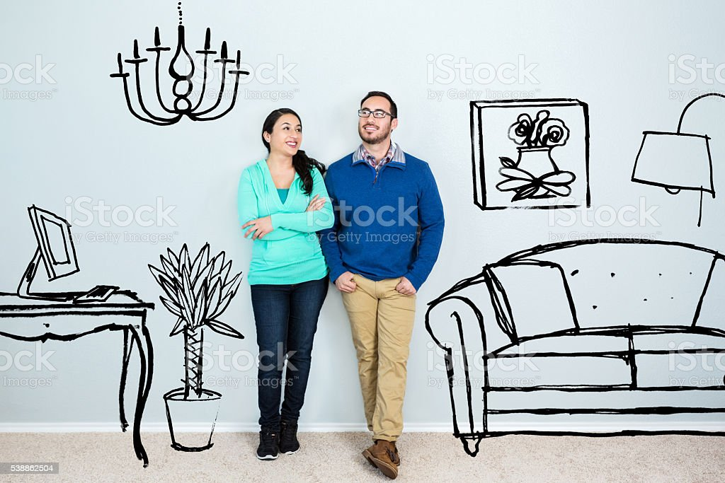 Mid adult Hispanic couple daydream in their new home stock photo