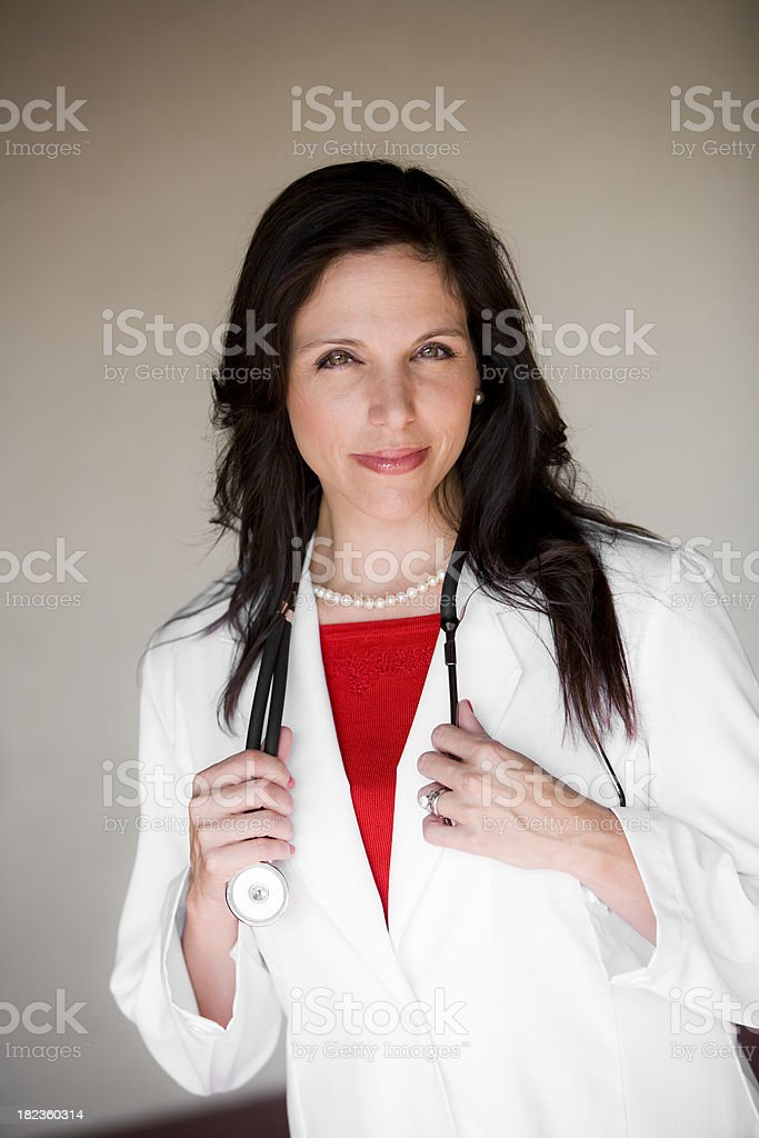 Mid adult hispanic female doctor stock photo