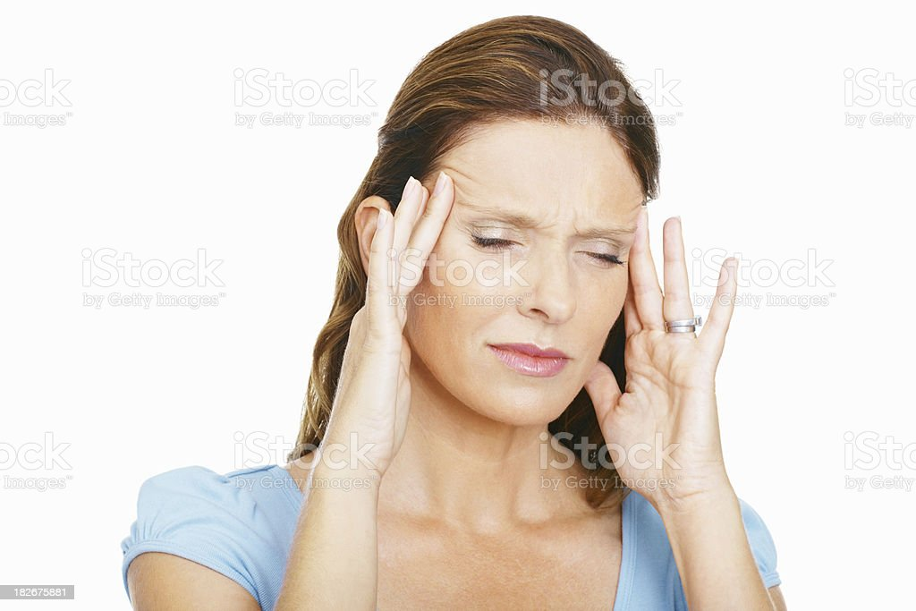 Mid adult lady suffering from a severe headache royalty-free stock photo