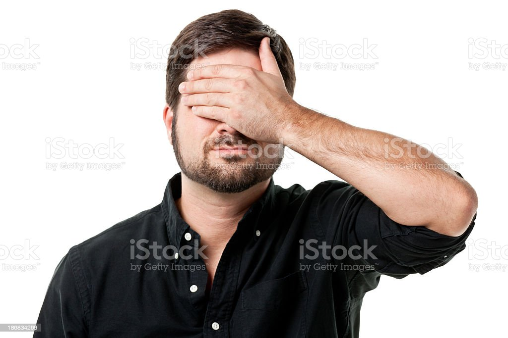 Mid Adult Male Covering Eyes stock photo