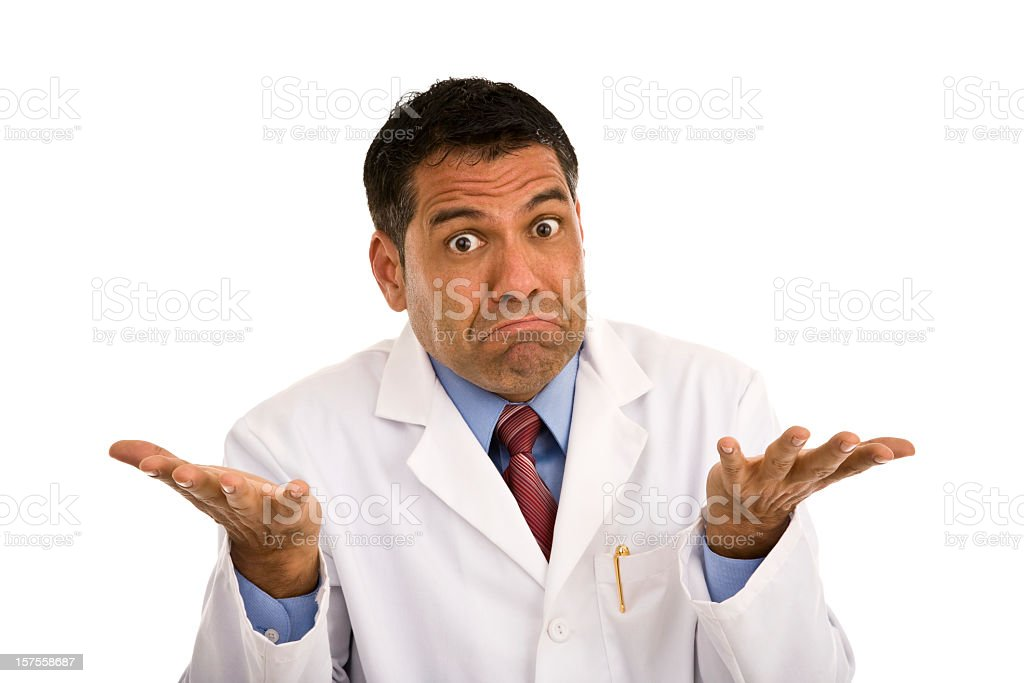 Mid adult male wearing lab coat gesturing making a face stock photo