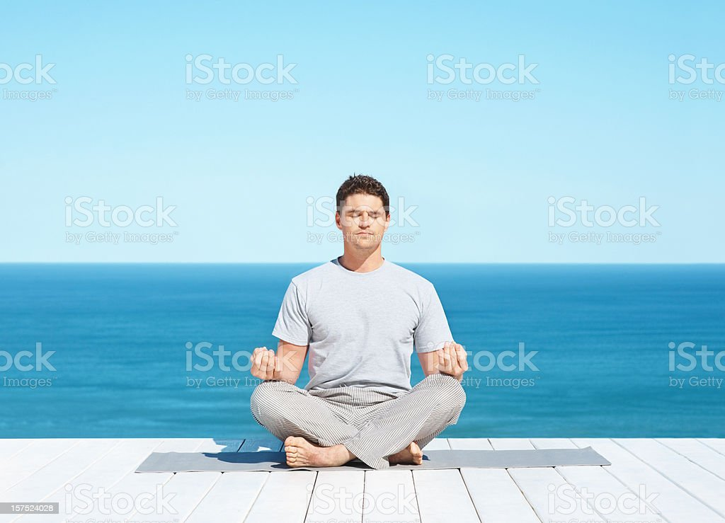 Mid adult man in a lotus position royalty-free stock photo
