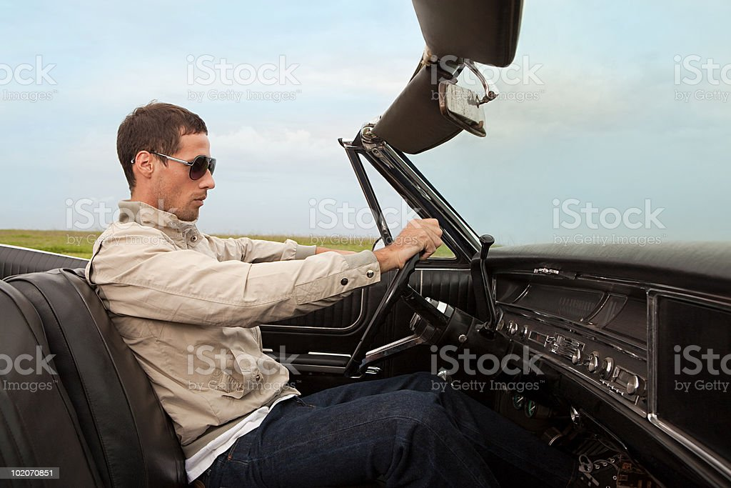 Mid adult man in convertible car stock photo
