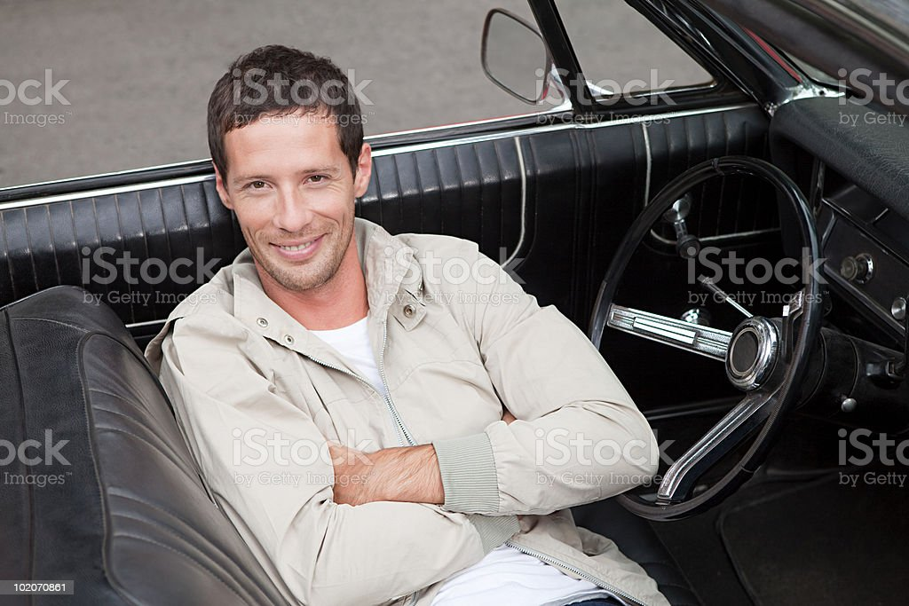 Mid adult man in convertible car royalty-free stock photo