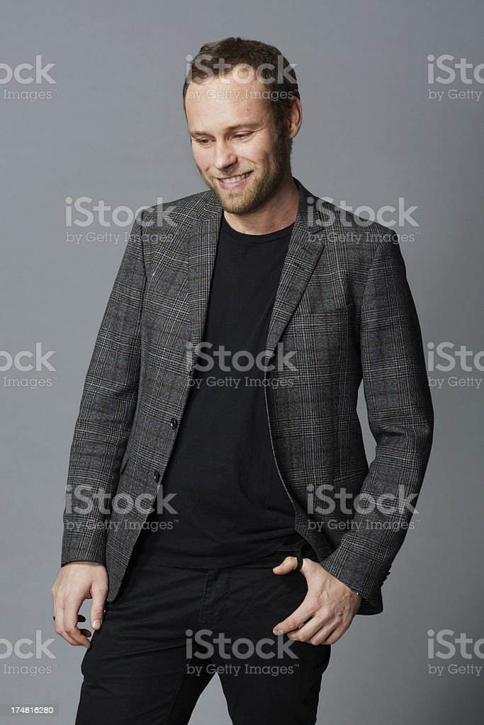 Mid adult man in grey jacket looking away royalty-free stock photo