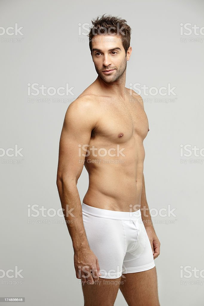 Mid adult man in underpants looking away, studio shot royalty-free stock photo