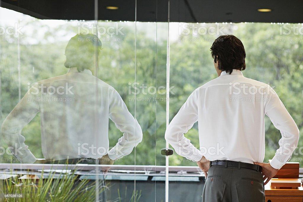 Mid Adult Man Looking Through Window stock photo