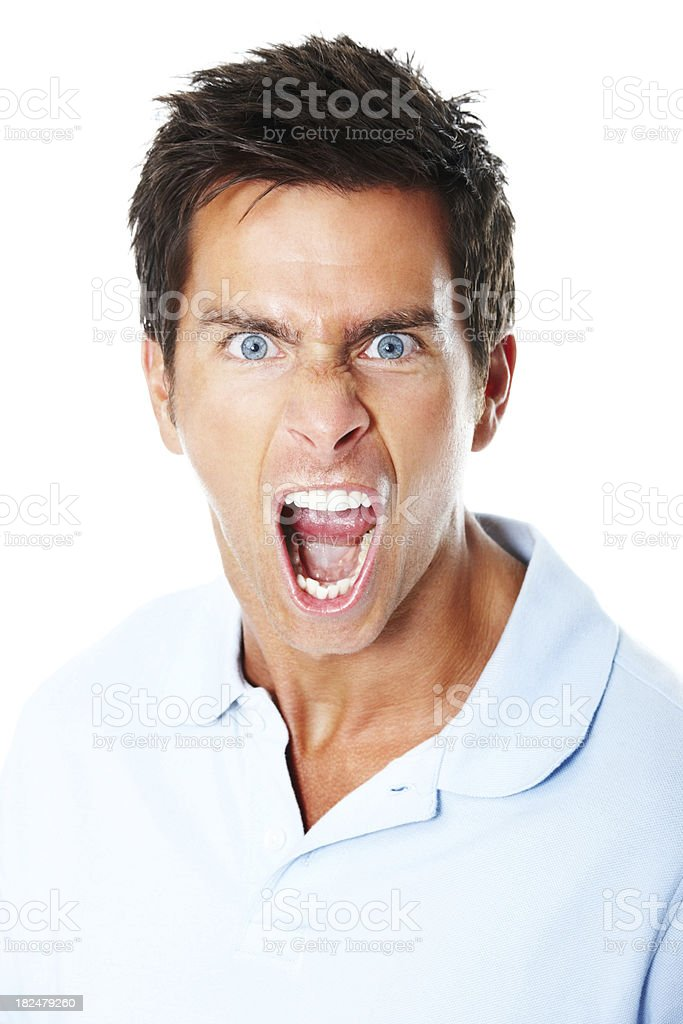Mid adult man screaming over white background stock photo