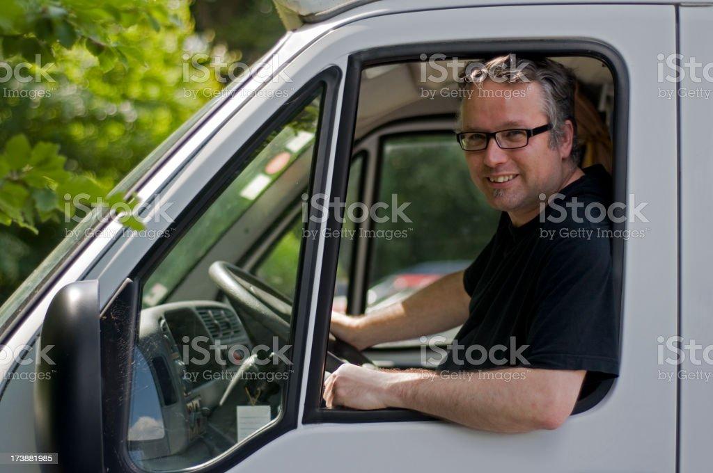 Mid adult man sitting at steering wheel van royalty-free stock photo