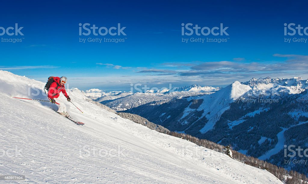 Mid adult man skiing on ski slope in winter stock photo