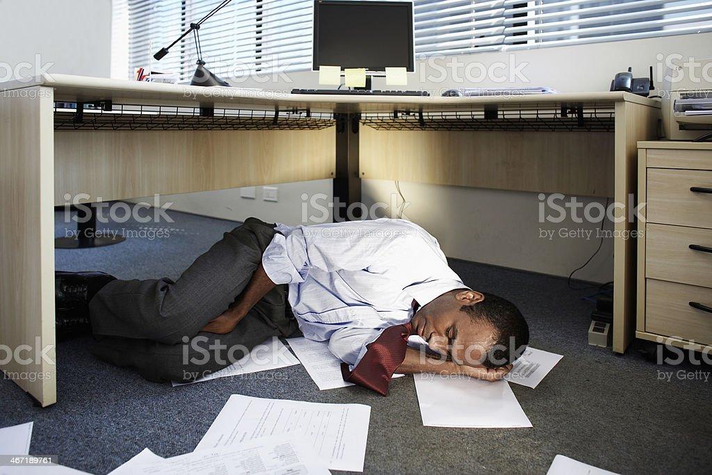 Mid Adult Man Sleeping Near Documents on Floor stock photo