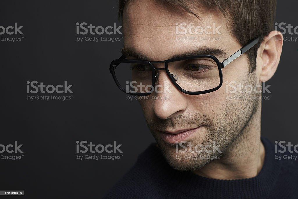 Mid adult man wearing glasses, studio shot stock photo