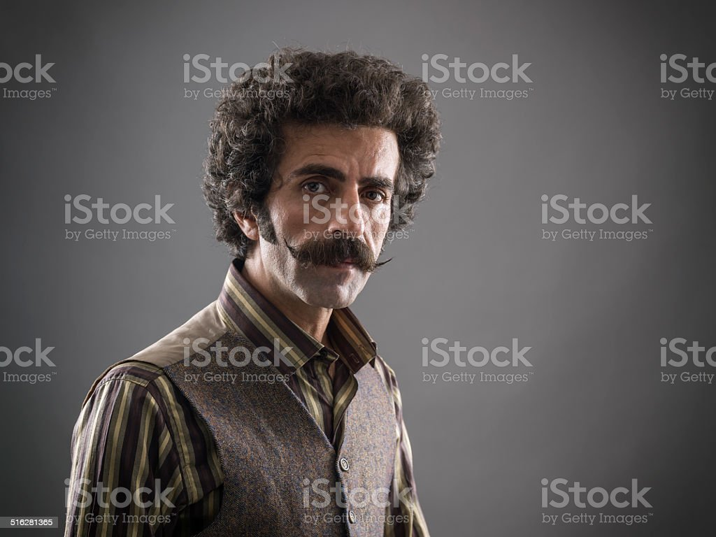 Mid adult man with handlebar mustache stock photo