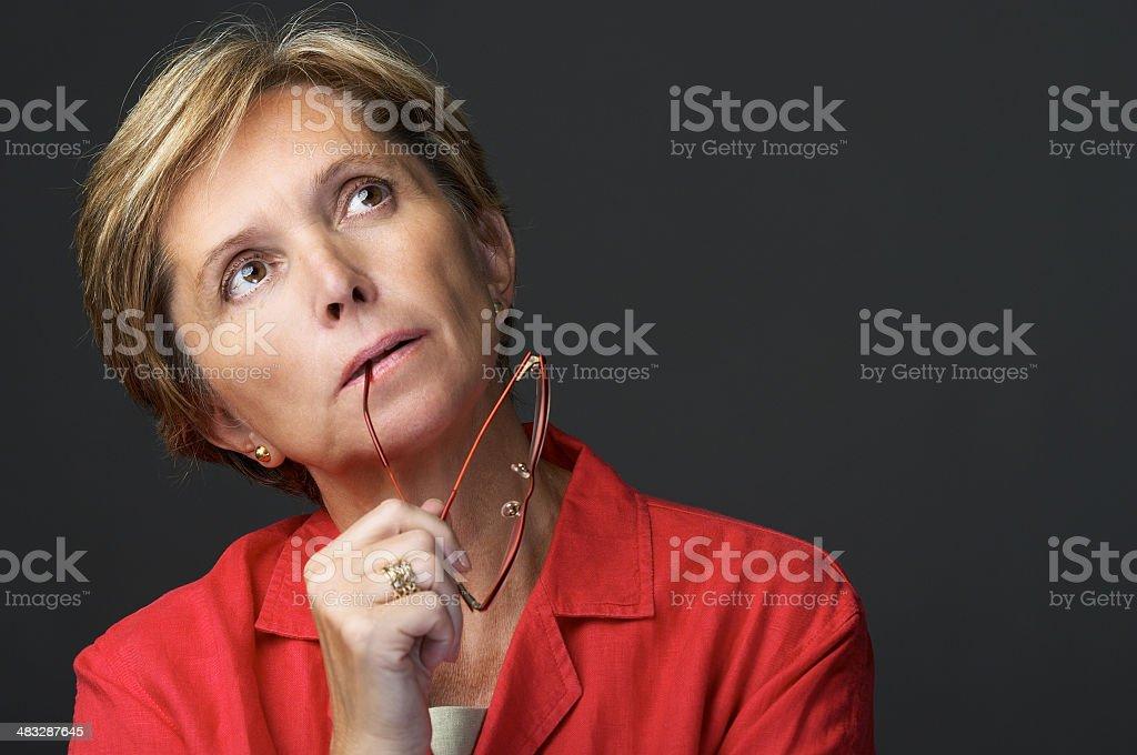 Mid adult thinking royalty-free stock photo