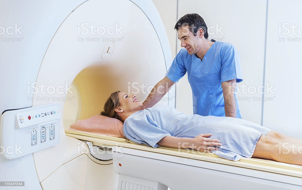 Mid adult woman getting MRI Scan. stock photo