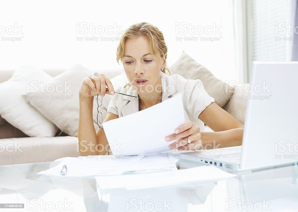 Mid adult woman going through her documents royalty-free stock photo