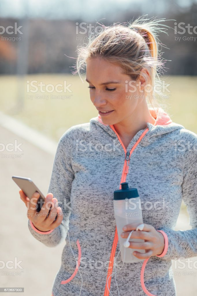 Mid adult woman jogging in park stock photo