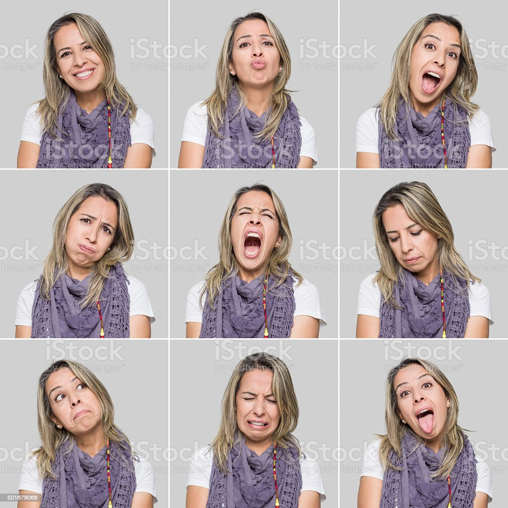 Mid adult woman making various facial expressions stock photo