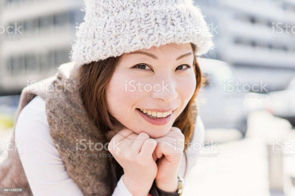 Mid adult woman relaxing in the city. stock photo