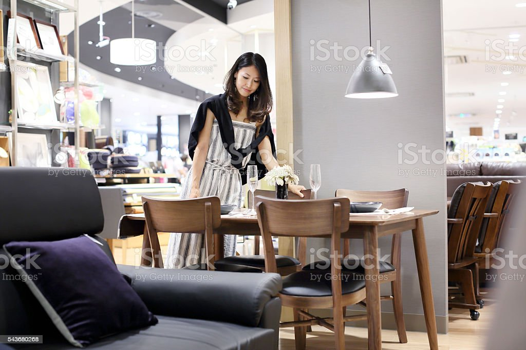 Mid adult woman shopping in shopping mall. stock photo