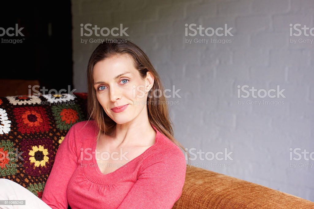 Mid adult woman smiling at home stock photo