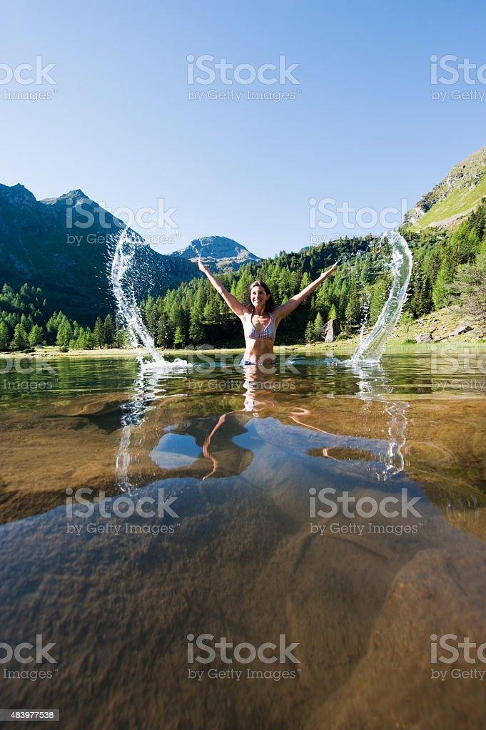 Mid adult woman standing in lake duisitzkar stock photo