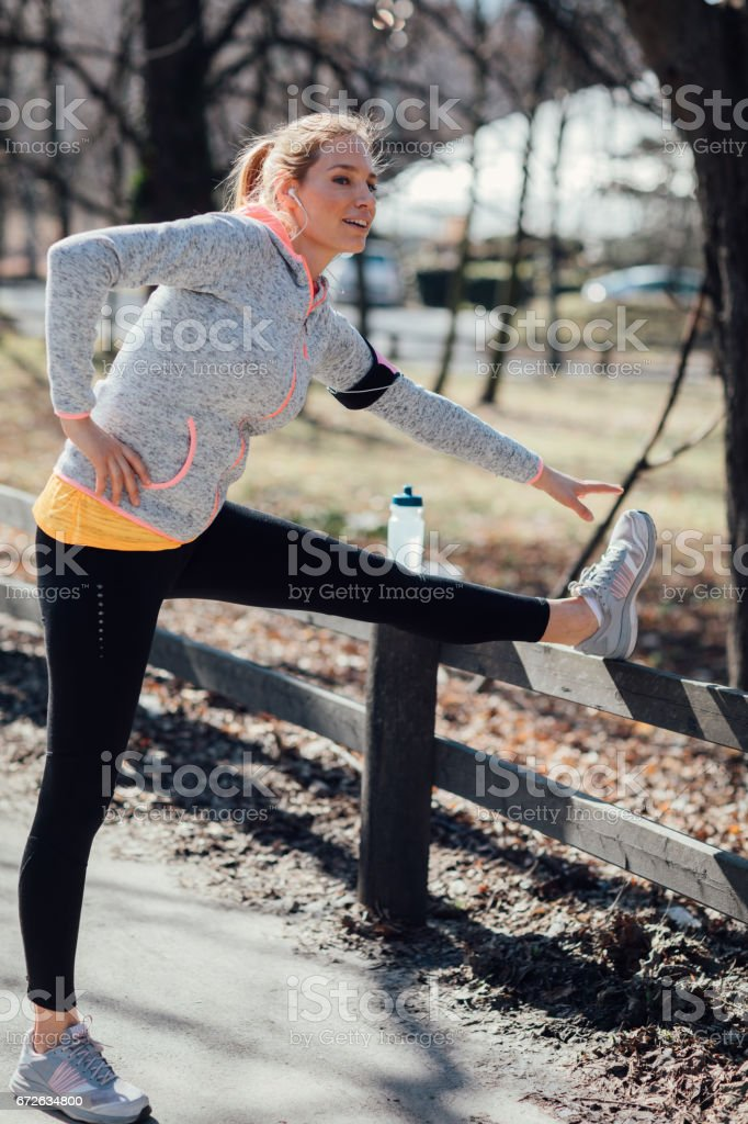 Mid adult woman streching after training stock photo