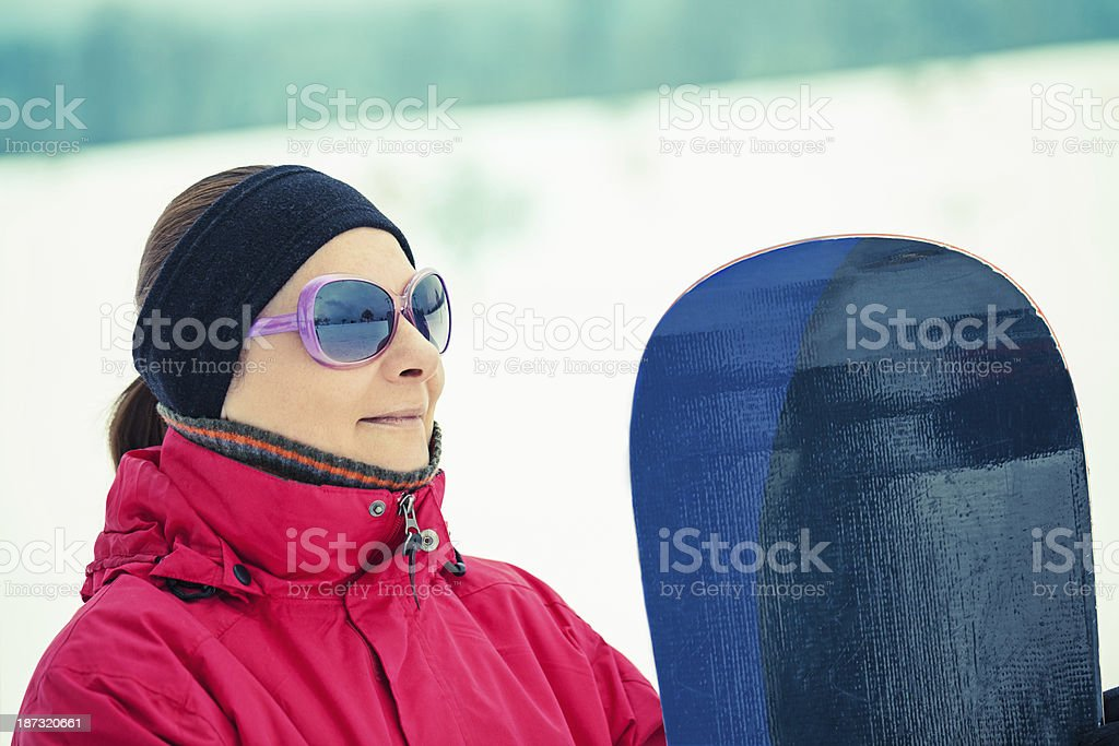 Mid adult woman with snowboard royalty-free stock photo
