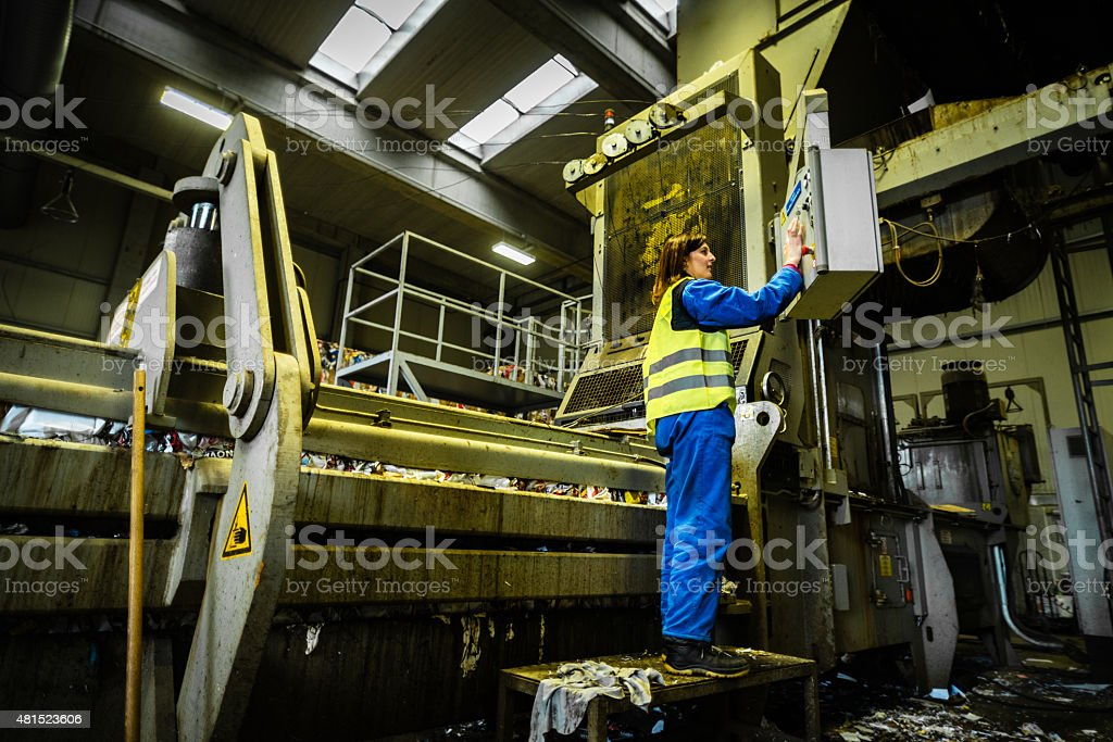 Mid adult woman working in factory stock photo