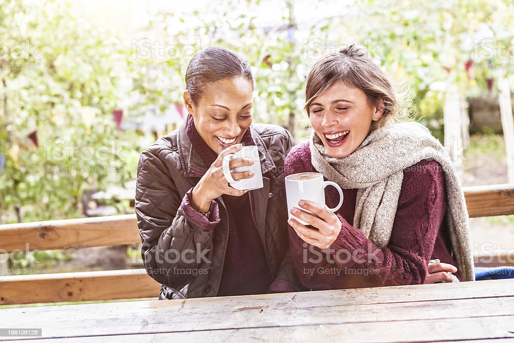 Mid Adult Women Enjoying a Warm Cup of Coffee royalty-free stock photo