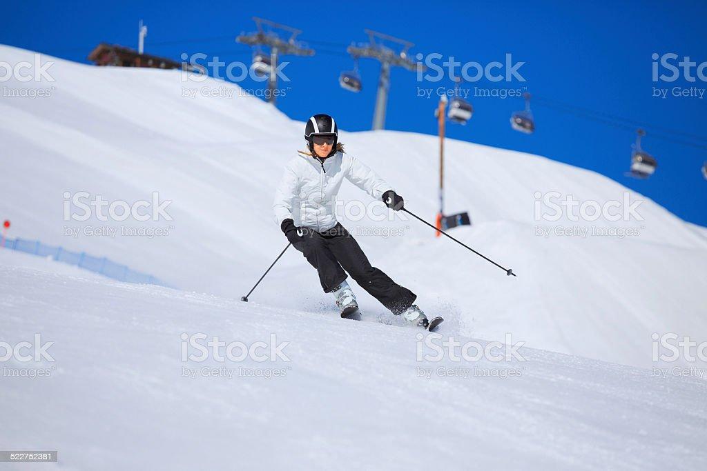 Mid adult women snow skier skiing, enjoying on sunny ski resorts...