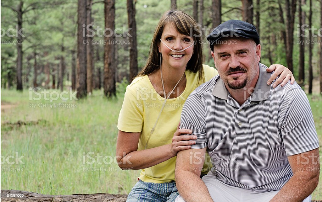 Mid Age Couple Women Wearing Oxygen stock photo