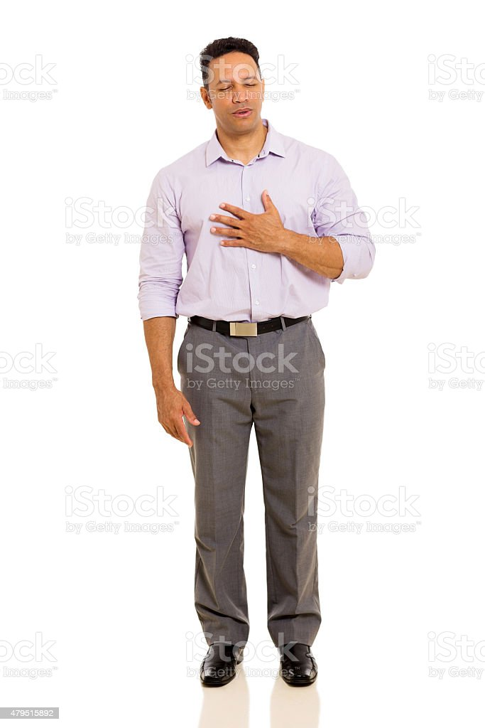 mid age man having chest pain stock photo