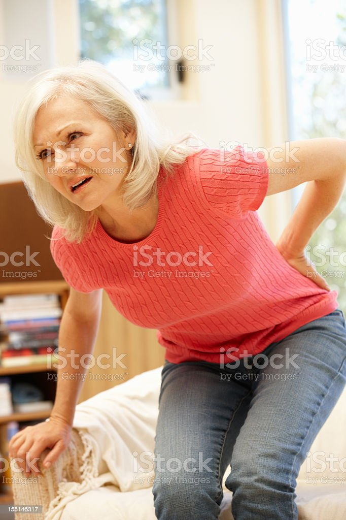 Mid age woman with backache stock photo