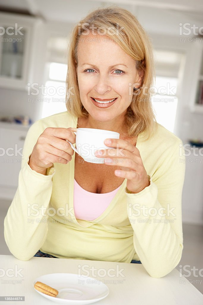 Mid age woman with coffee at home royalty-free stock photo