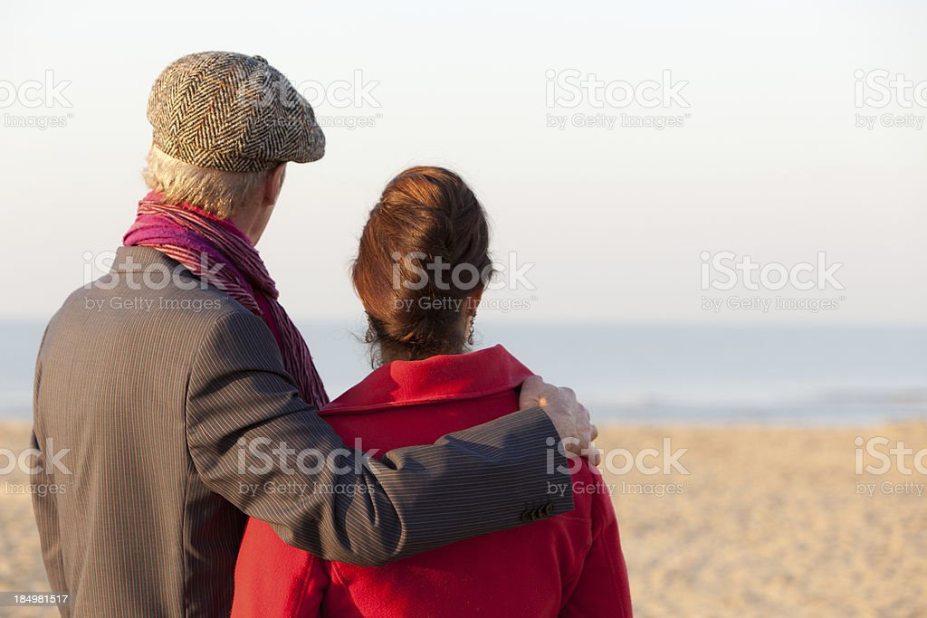 Mid aged couple looking at beach stock photo