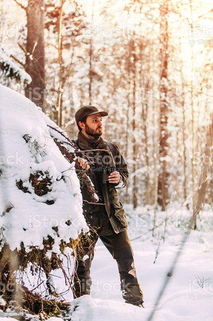 Mid Aged Man Exploring The Nordic Forests In Winter stock photo